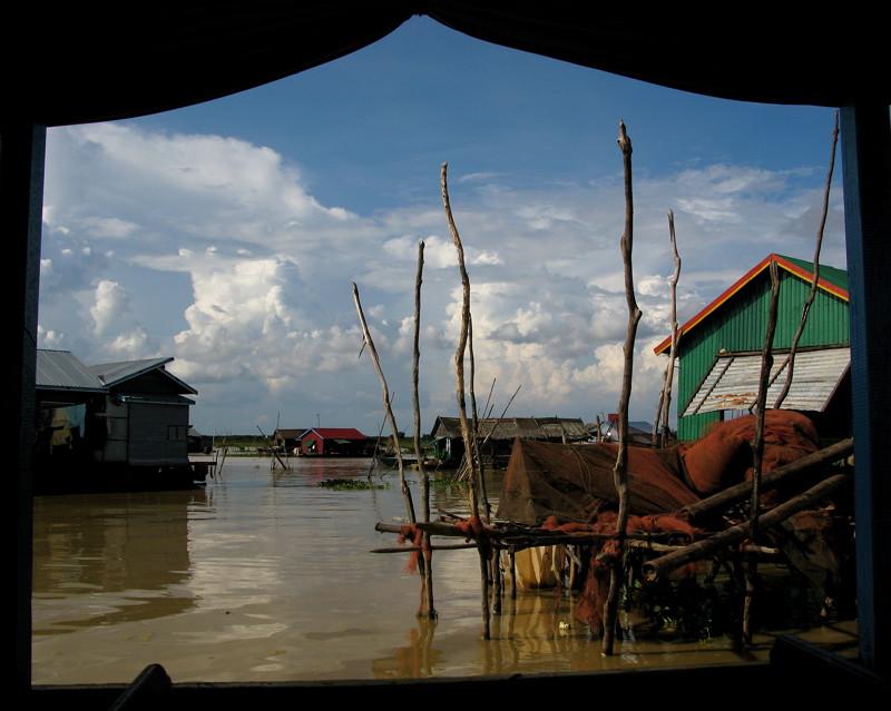Vietnamese-Khmer floating village of Chong Khneas by Adventurocity