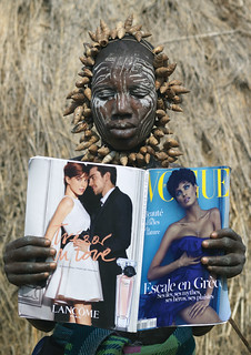 Mursi tribe Woman Reading Vogue Magazine - Omo Valley Ethiopia