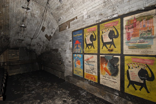 Vintage 1950s advertising posters in disused passageways at Notting Hill Gate tube station, London - photographed in 2010