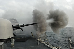 PACIFIC OCEAN (June 6, 2011) The MK-75 76mm mounted gun aboard the guided-missile frigate USS Thach (FFG 43) is fired during a live-fire exercise off the coast of Chile. (U.S. Navy photo by Mass Communication Specialist 3rd Class Stuart Phillips)