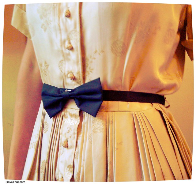 DIY bow belt using black Grosgrain ribbon and a vintage bow tie pin make your own reusable gift wrapping embellishments