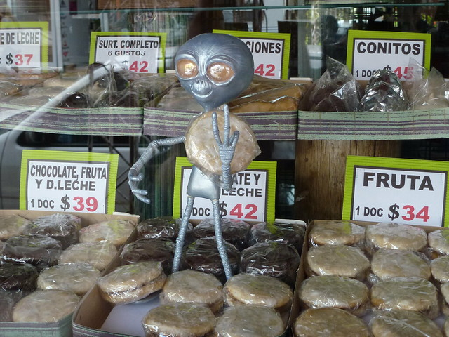 Alien offering alfajores for sale in Capilla del Monte, Argentina