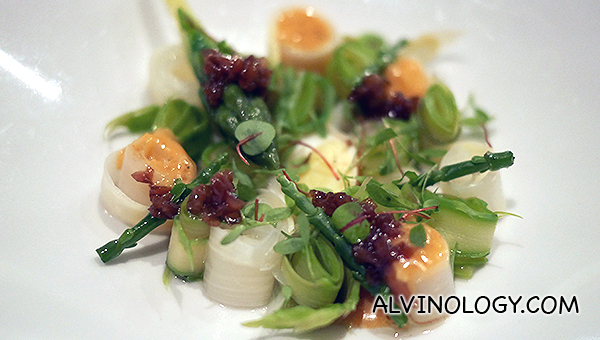 Beautiful asparagus with a quail egg in the middle.