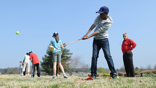 Youths learn golf training tips through First Tee