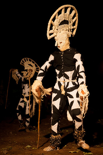 fiber Masks of nigeria in the Festival des Masques de Dédougou in the night, Burkina Faso by ronnyreportage