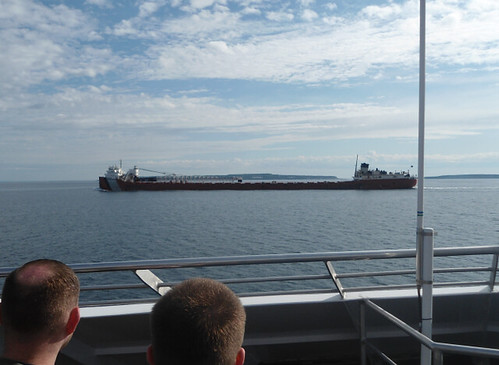 view of stone and iron freighter John G. Munson from Star Line ferry deck
