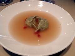 Oolong soup with salmon dumpling in basil skin at…