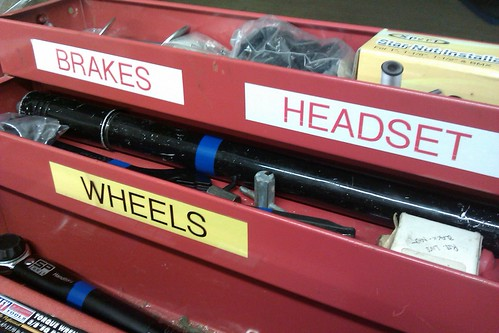 Three compartments of a toolbox labeled Brakes, Headset and Wheels