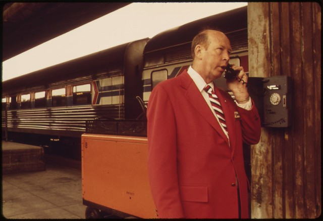 Amtrak employee checks with the station at the Los Angeles Union Passenger Terminal, May 1974