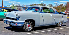 1955 ford(0.0), plymouth cranbrook(0.0), convertible(0.0), automobile(1.0), automotive exterior(1.0), vehicle(1.0), custom car(1.0), mid-size car(1.0), compact car(1.0), antique car(1.0), sedan(1.0), classic car(1.0), vintage car(1.0), land vehicle(1.0), luxury vehicle(1.0), motor vehicle(1.0),