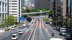 public transport(0.0), residential area(0.0), traffic congestion(0.0), pedestrian crossing(0.0), metropolitan area(1.0), highway(1.0), traffic(1.0), transport(1.0), road(1.0), metropolis(1.0), urban area(1.0), cityscape(1.0), lane(1.0), controlled-access highway(1.0), overpass(1.0), city(1.0), downtown(1.0), street(1.0), neighbourhood(1.0), pedestrian(1.0), infrastructure(1.0), intersection(1.0),