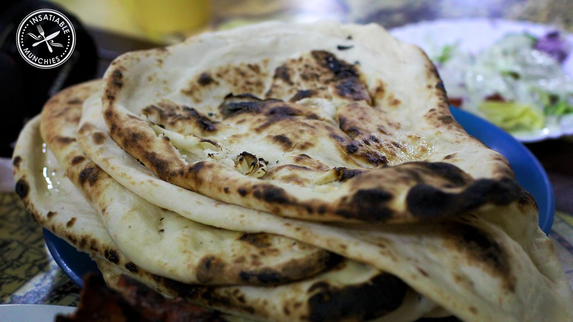 A mixture of naan, plain and kashmiri