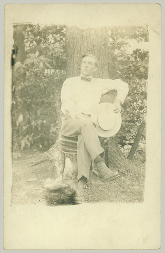 Seated man with hat