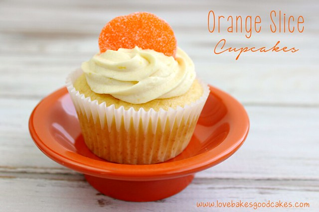 Orange Slice Cupcake in orange bowl with an orange candy on top close up.