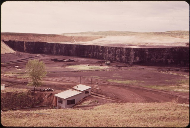 DOCUMERICA: The Wyodak Coal Mine near Gillette, Wyoming. Long-range plans call for massive strip-mining of the Powder River Basins and the construction of huge power plants. One of the power plants will be constructed at Gillette, 06/1973 by Boyd Norton.