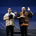 Ric Salinas (l.) and Herbert Siguenza play American immigrants who are very excited to attain U.S. citizenship, in the Huntington Theatre Company's production of