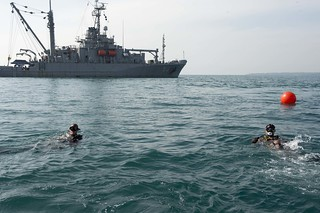 Sailors dive on the site of the Navy vessel USS Houston (CA 30). | by Official U.S. Navy Imagery