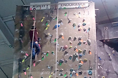 Students from the Talent Search department at MSSU climb a rock wall.
