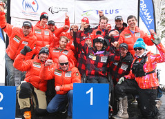The Canadian team celebrates Josh Dueck's IPC World Cup super-G win in Panorama, B.C.