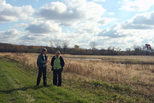 Left to Right, NRCS biologist Kristen Westad visits the wetland restoration area with landowner Elsbeth Fuchs on her Wisconsin farm.