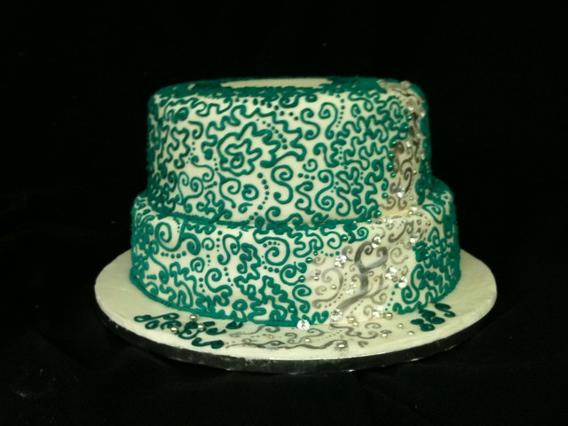 Teal Wedding cake Will have flowers on top Chocolate mudcake with chocolate