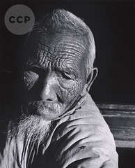 Village Elder, over 100, with Fly on Shoulder, China, by John Gutmann 1943