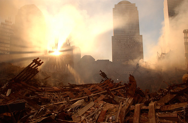 The sun streams through the dust over the wreckage of the World Trade Center on September 15, 2001, by Andrea Booher
