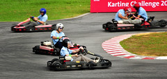 auto racing(0.0), formula racing(0.0), dirt track racing(0.0), formula one(0.0), formula one car(0.0), go-kart(1.0), kart racing(1.0), racing(1.0), vehicle(1.0), sports(1.0), race(1.0), motorsport(1.0), race track(1.0),