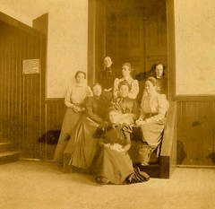 A photo of class of 1899 Miss May McKinney; Miss Eliz. Keys; Miss Grace Sharp; Miss Nellie Morse; Miss Mary Harris; Miss Mariana Bertola; Mrs. Beatrice Hinkle; Mrs. Elizabeth Grotefend