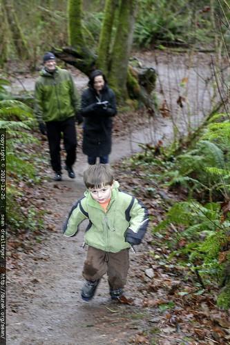 sequoia leads his grandparents through the woods