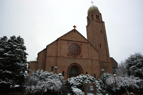 Saint John The Evangelist Catholic Church under a snowfall, brick with cross topped tower, Greenwood, Seattle, Washington, USA by Wonderlane