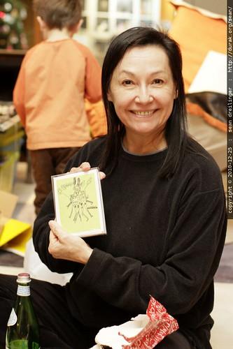 grandma neeta unwraps some cards made from nick's second grade art