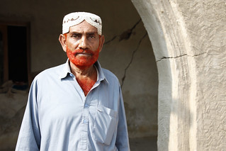 Roshan Ali, 60, stands in front of the remains of his flood-damaged home, in Pakistan's Sindh Province