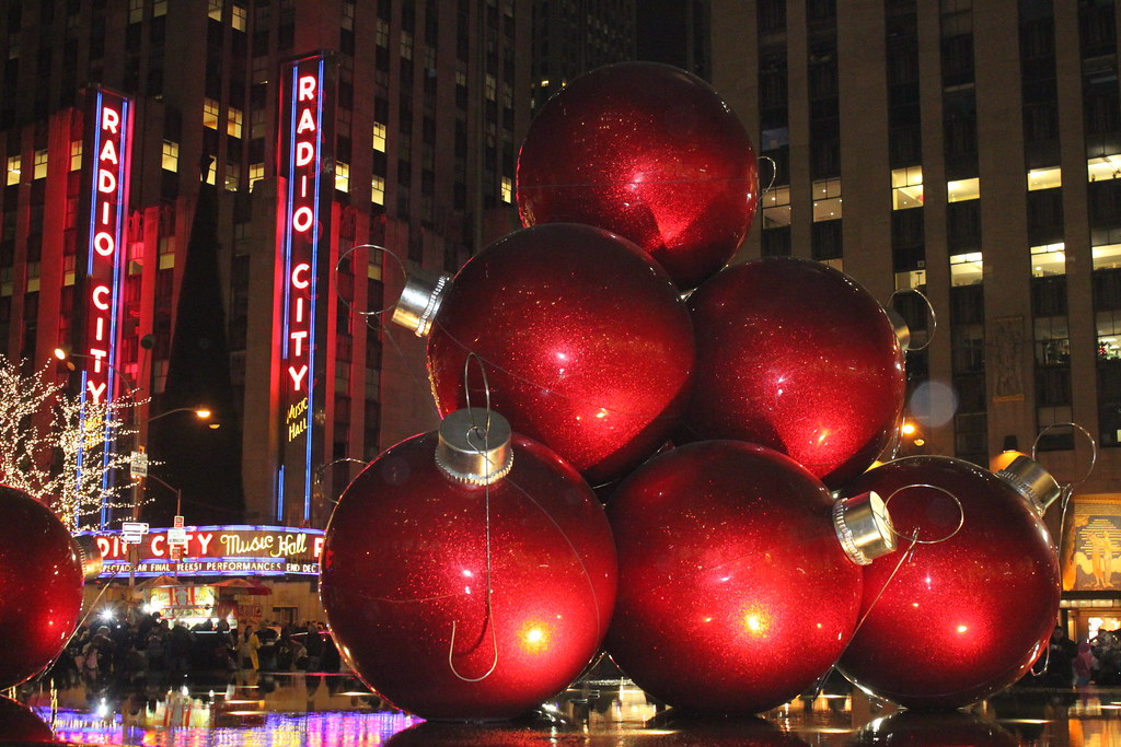 some big red christmas tree ornaments by radio city in nyc - Large Red Christmas Decorations