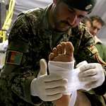 British Trained Afghan Army Medic Treats a Casualty