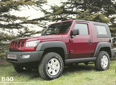 Cross between a Jeep and a Hummer. By: JOHN LLOYD
