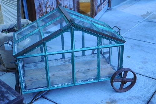 Portable flower garden on wheels, glass and iron, University Village, Seattle, Washington, USA by Wonderlane