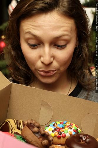 megan, contemplating a box of voodoo doughnuts