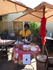 World Aids Day 2010 - Cake Sale :: The Backpack Cape Town posted a photo: 	   Thando at the cake table  This year we decided to have a cake sale and donate the proceeds to the Baphumelele Childrens home in Khayelitsha.  All the staff members baked something and Thando sold the cake to guests and businesses in the area.