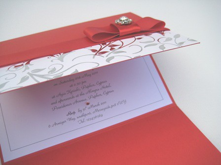 handmade red and silver wedding invitations in wallet with red satin ribbon