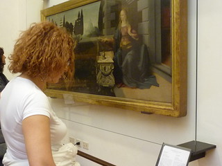 Visitor reading the artwork's label, Galeria degli Uffizi