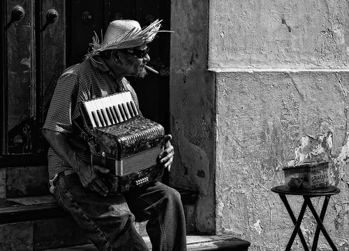 street portrait bw texture hat break gracias cigarette candid smoke entertainer accordian performer lowkey tonalcontrast