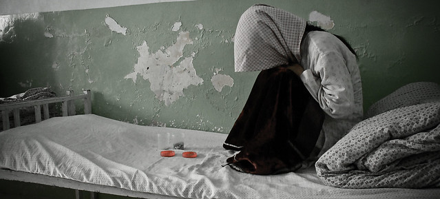 Female opium addict hides her face - Mazar-i-Sharif detox centre