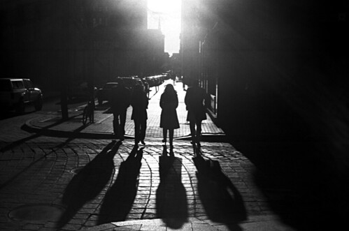 street city light shadow people sun silhouette dark downtown walk streetphotography providence cobblestone strong subject kodakbw400cn yashicaelectro35gsn contast ruckenfigur coloryashinondx45mmf17