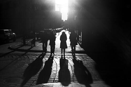 street city light shadow people sun silhouette dark downtown walk streetphotography providence cobblestone strong subject kodakbw400cn yashicaelectro35gsn contast ruckenfigur coloryashinondx45mmf17