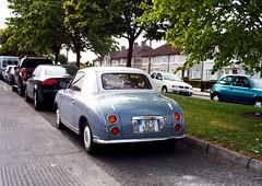 automobile, wheel, vehicle, automotive design, nissan figaro, subcompact car, city car, compact car, antique car, classic car, vintage car, land vehicle, sports car,