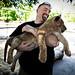 Adam holding a lion cub by dmertl