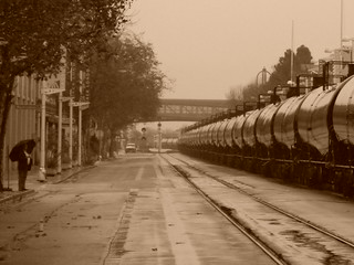 A unit ethanol train creeps through Jack London Square on a wet northern cali afternoon