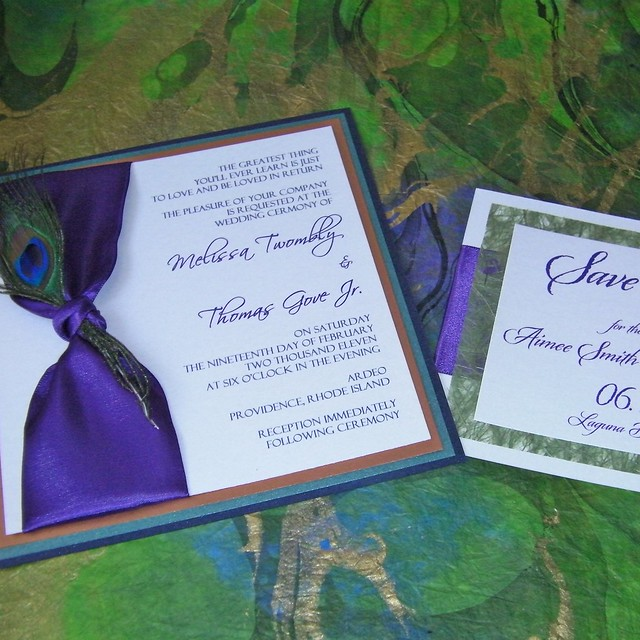 Peacock feather Save the Date and Wedding Invitations that feature satin
