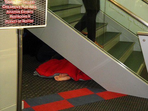 Spending the Night Under the Stairs at the Airport I